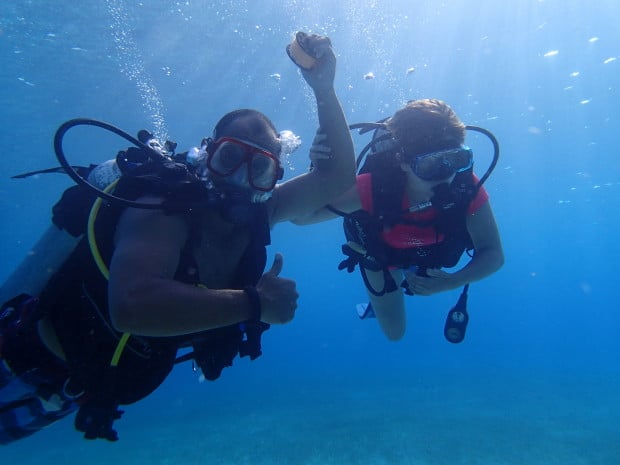 Scuba diving was a new and unsettling experience at first for Victoria. Adolfo stayed by her side and insisted she stick with it.