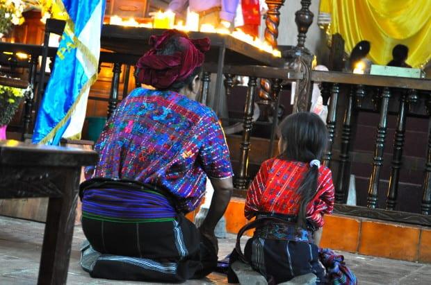 A woman and child pray in Panajachel, Guatemala