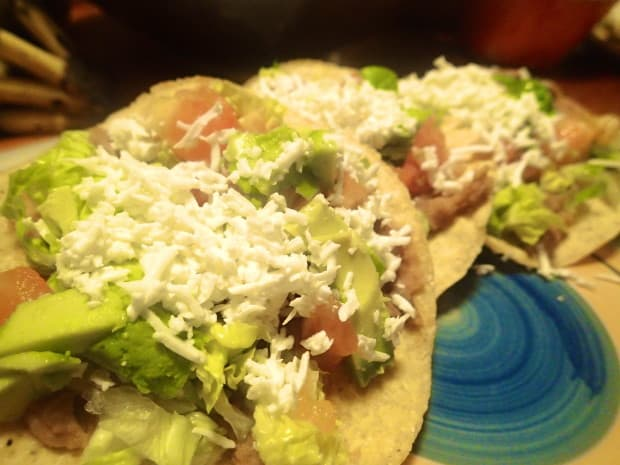 Tostadas are a favorite of Central American street vendors- they are cheap and easy to make. That combination also makes them a great thing to experiment with in your own kitchen.